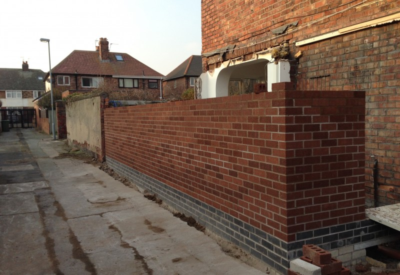 Sidestreet view mid construction wall Crosby
