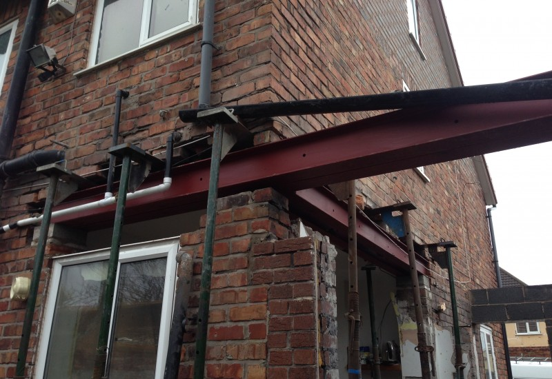 Girders in place wrap around extension crosby