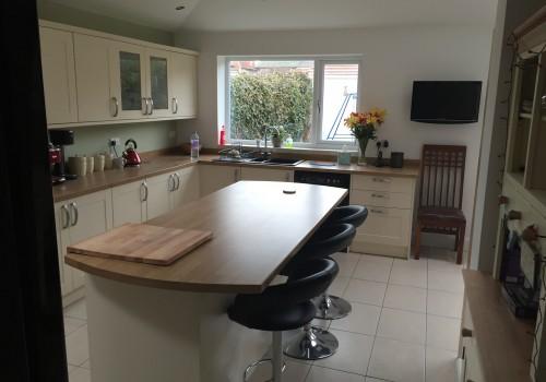 side View kitchen island wrap around extension