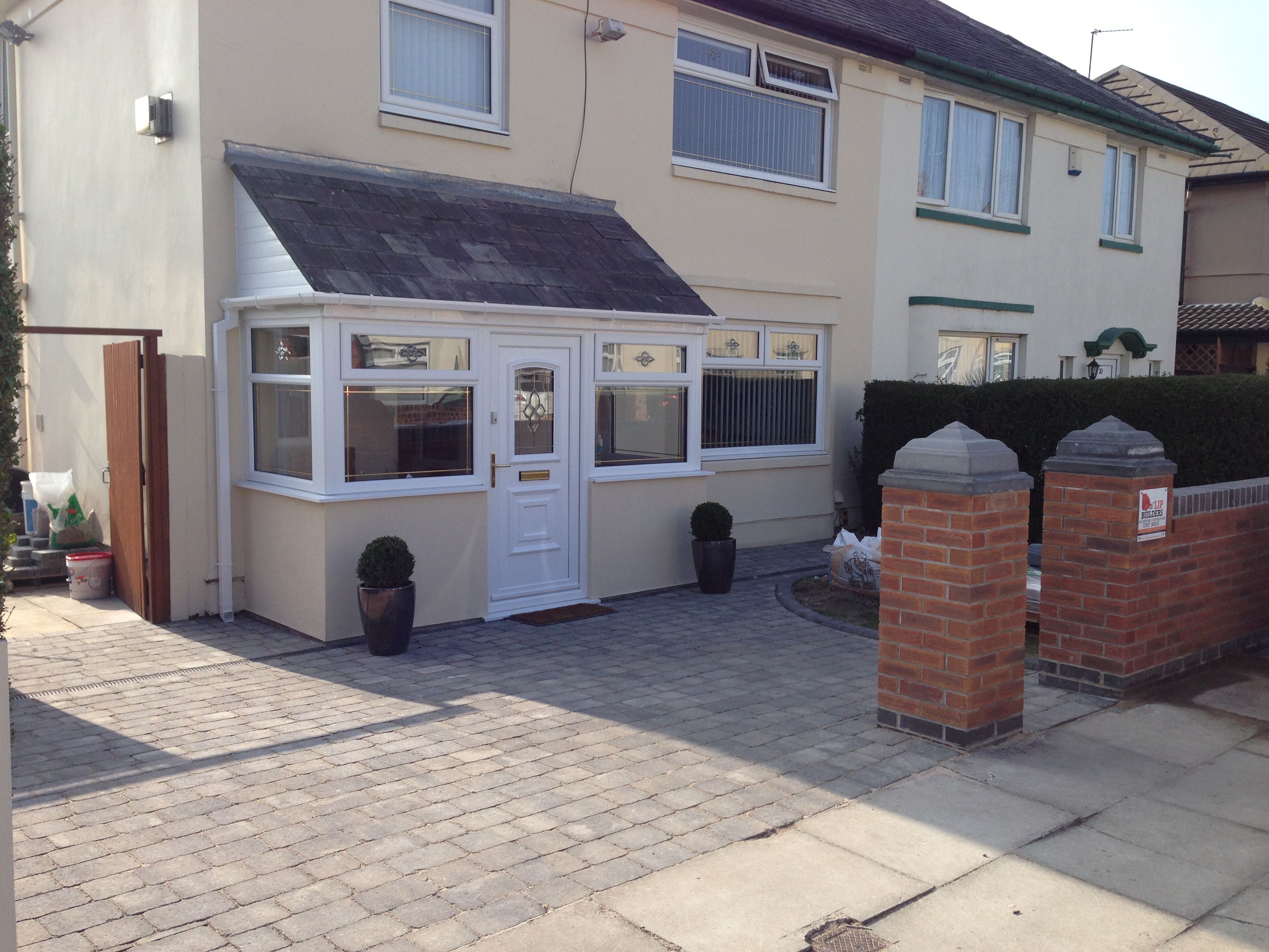 Complete porch,garden wall and paving