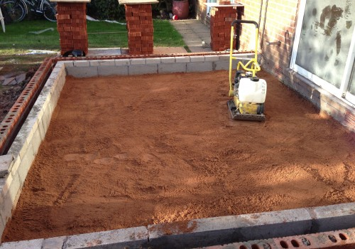 Smoothing the sand Congleton Orangery